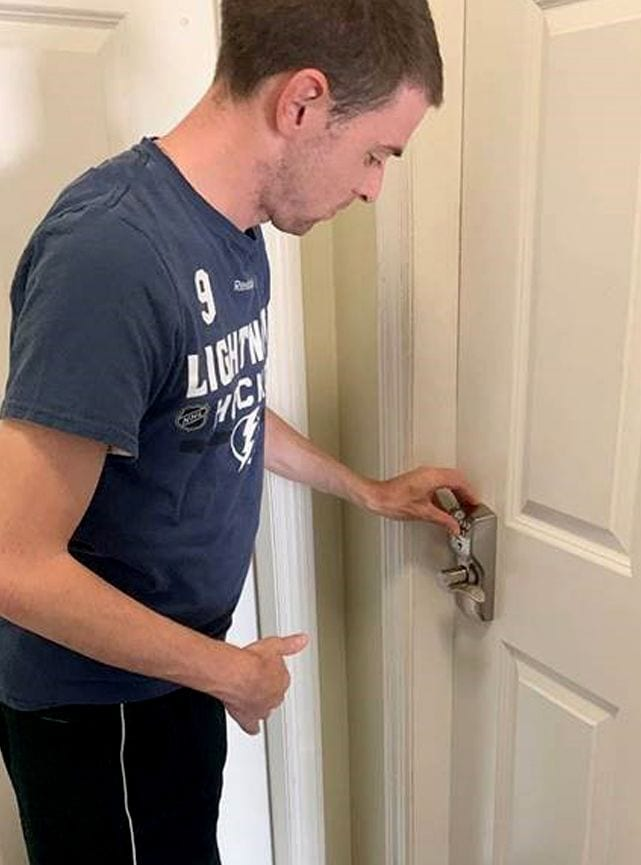 Person uses keyless entry on door
